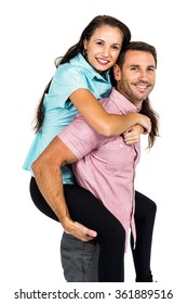 Smiling man carrying his girlfriend on back while standing over white background