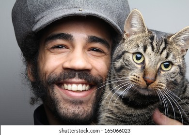 Smiling man with cat