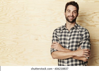 Smiling man in checked shirt, portrait