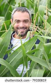 Smiling man in a corn field