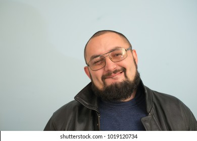 smiling man with crossed arms over gray background