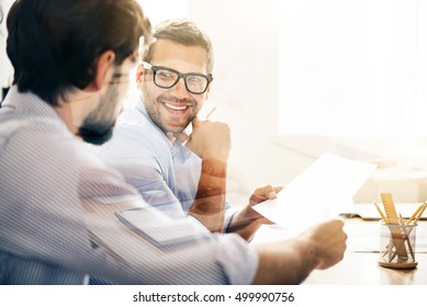 Smiling man during business meeting with his partner