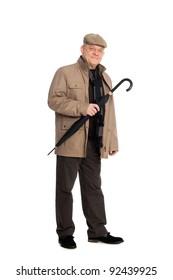 Smiling man in elegant clothes autumn with an umbrella.