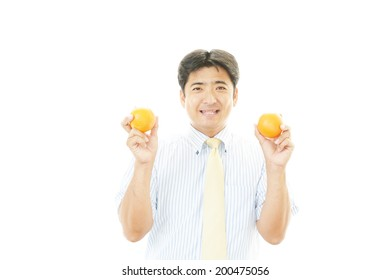 Smiling man with fruits