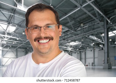 Smiling man in glasses poses in modern empty warehouse, collage