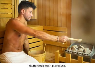 Smiling man having a sauna bath in a steam room