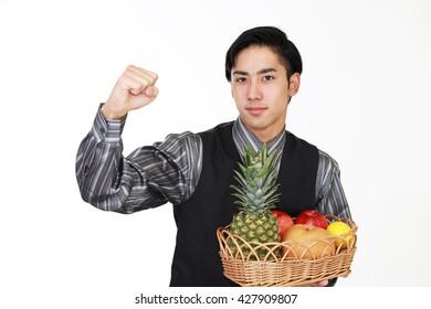 Smiling man holding fruits