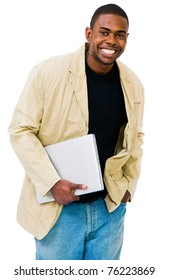 Smiling man holding a laptop and posing isolated over white