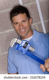 Smiling man holding wrench