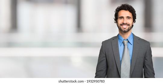 Smiling man, large bright background, wide banner image