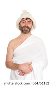 Smiling man of middle-aged dressed in traditional bath. From a series of Russian bath.