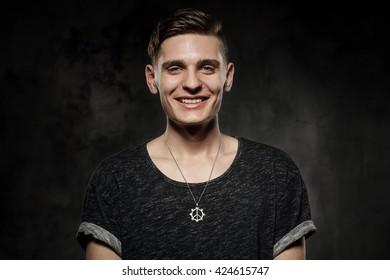 smiling man on a dark background