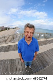 Smiling man on a pier - shot with a fish-eye lens