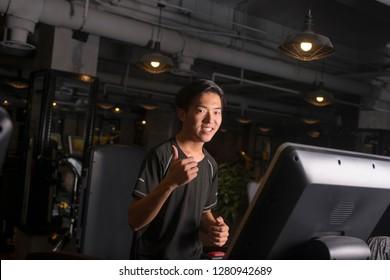 Smiling man on treadmill at the gymSmiling man on treadmill at the gym