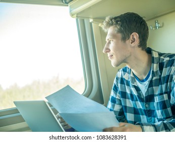 smiling man portrait sitting next to window in the train