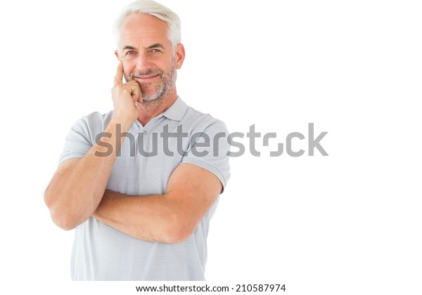 Smiling man posing with arms crossed on white background