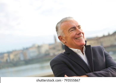 Smiling man with salt-and-pepper hair