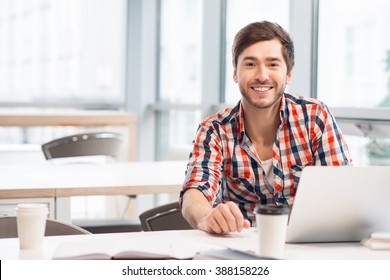 Smiling man sitting at the table