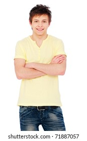 smiling man standing with arms crossed. isolated on white background