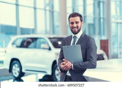 Smiling man in suit indoors
