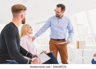 Smiling man talking to pretty woman