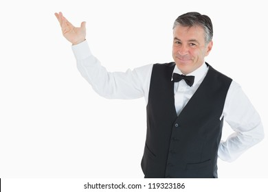 Smiling man in waistcoat pointing to something in the air