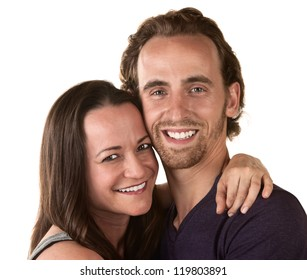 Smiling man and woman holding each other over white background