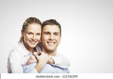 smiling man and woman on white background