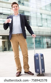 Smiling man worker going with baggage and keeping coffee on the hand