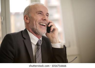 Smiling manager during a phone call