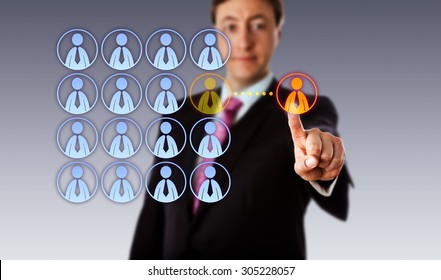 Smiling manager is touching a single male white collar worker icon outside an organized group of male employee icons. Business metaphor for outsourcing, crowdsourcing, hiring and contracting.