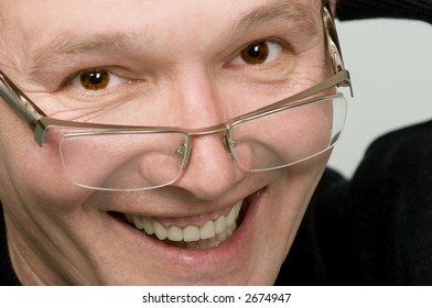 The smiling man's person in glasses