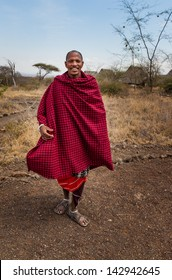 Smiling Masai warrior in traditional blanket