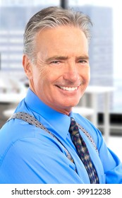 Smiling mature  businessman in the office