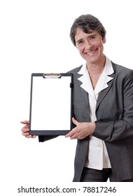 smiling mature businesswoman showing blank paper on notepad isolated on white background