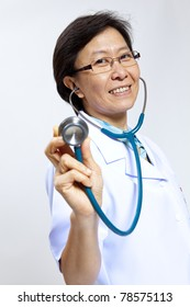 Smiling mature female medical doctor with stethoscope.