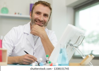 smiling mature male doctor in lab