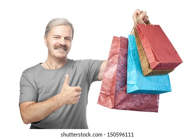 smiling mature man holding shopping bags isolated on white background