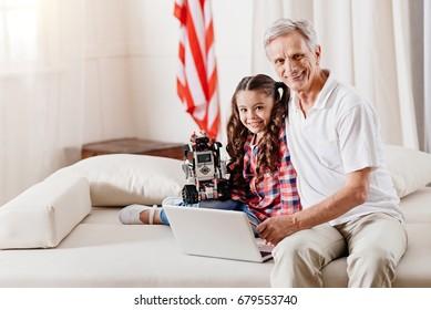 Smiling mature man looking straight at camera