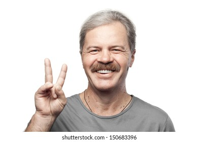 smiling mature man showing victory sign isolated on white background