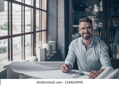 Smiling mature man at work in the studio