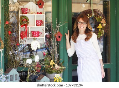 Smiling Mature Woman Florist Small Business Flower Shop Owner. Shallow Focus.