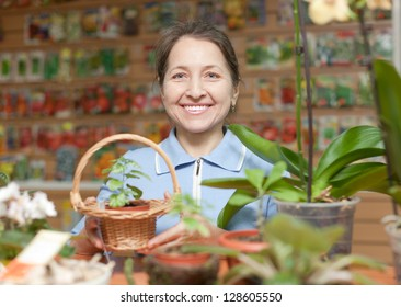 Smiling mature woman in  garden shop