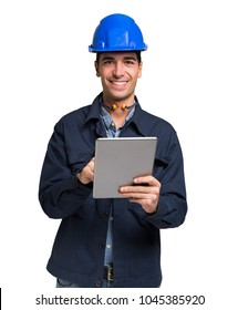 Smiling mechanic using a tablet. Isolated on white