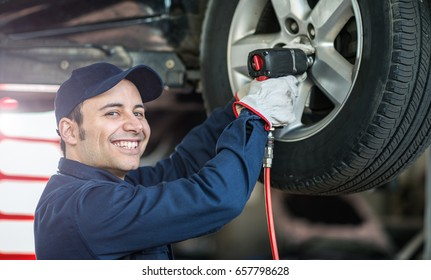 Smiling mechanic at work