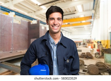 Smiling mechanical worker portrait