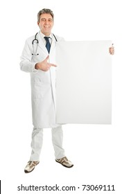 Smiling medical doctor presenting empty board