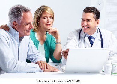Smiling medical doctor with senior couple. Health care.