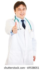 Smiling medical doctor showing thumbs up gesture  isolated on white