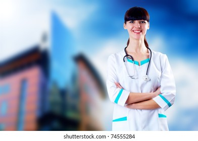 Smiling medical doctor with stethoscope on the hospitals background